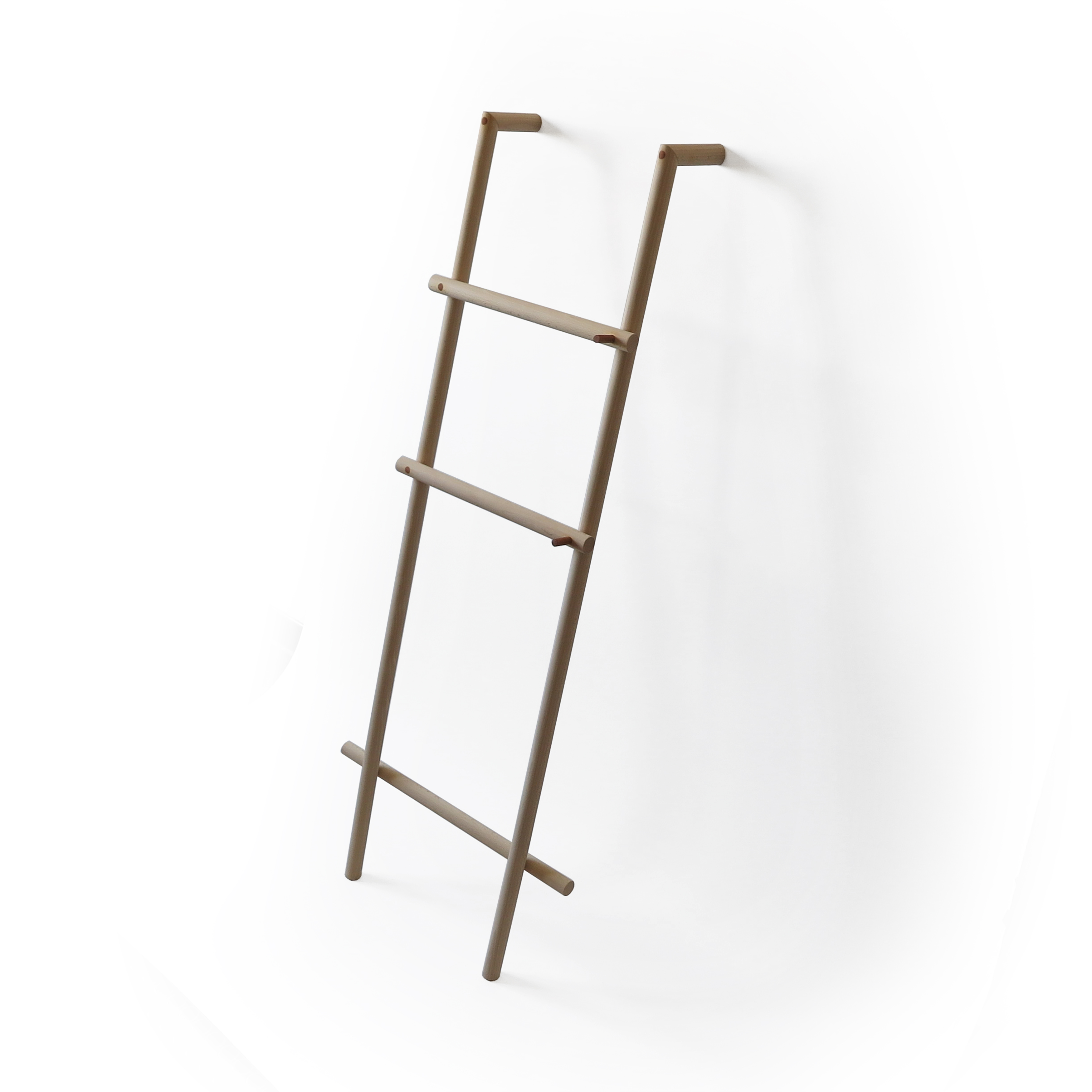 wooden ladder towel holder on the wall