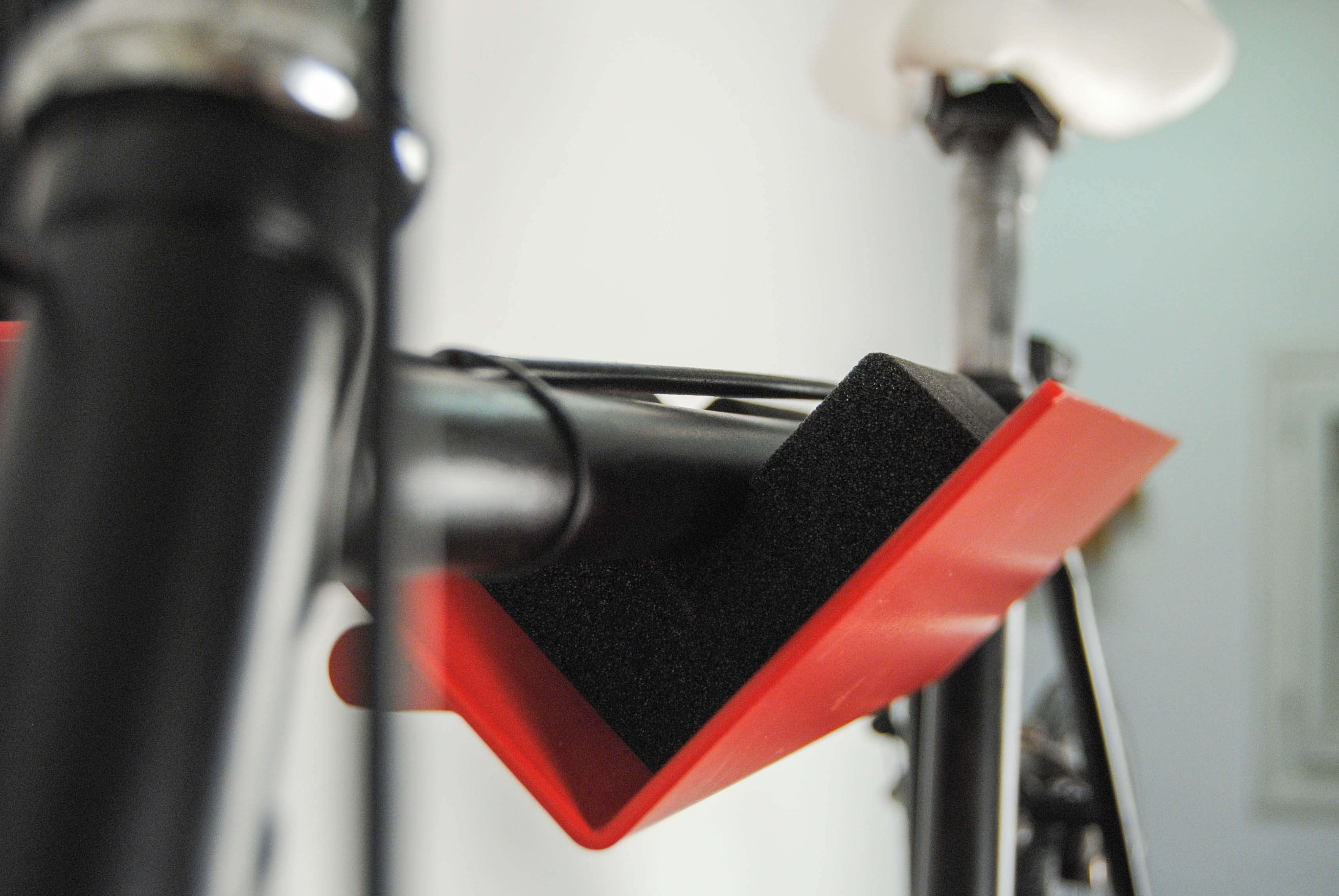metallic bike up red on the wall
