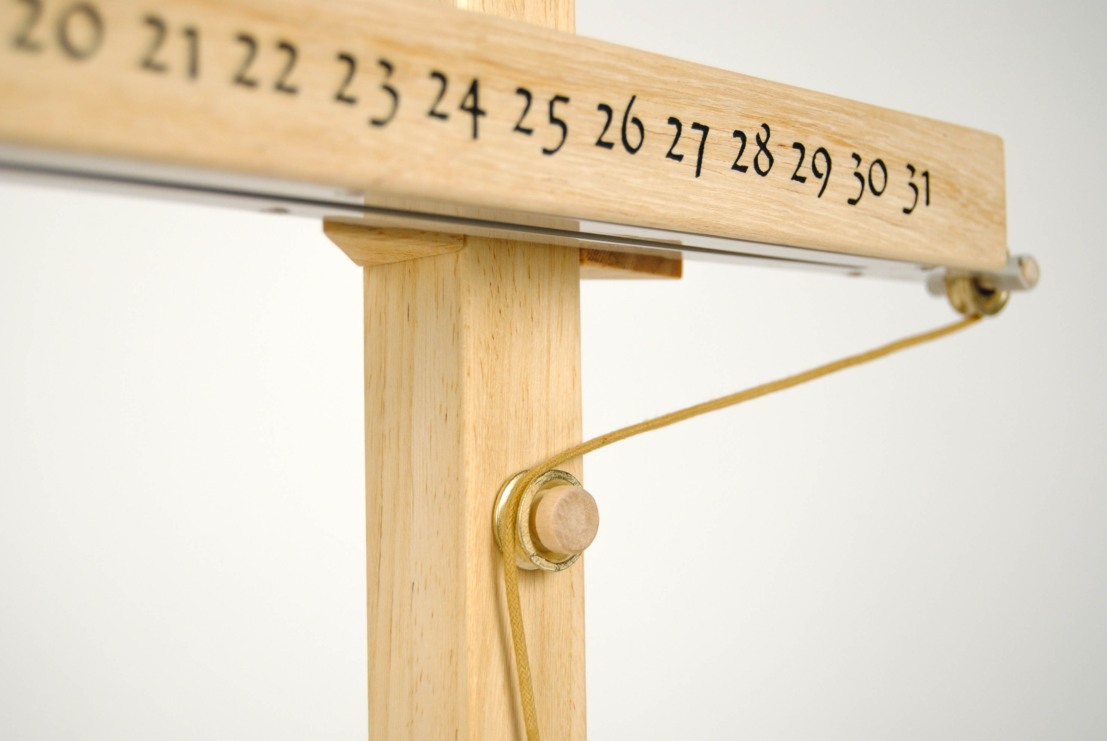 leonardo da vinci wooden calendar with printed numbers and rope for the date