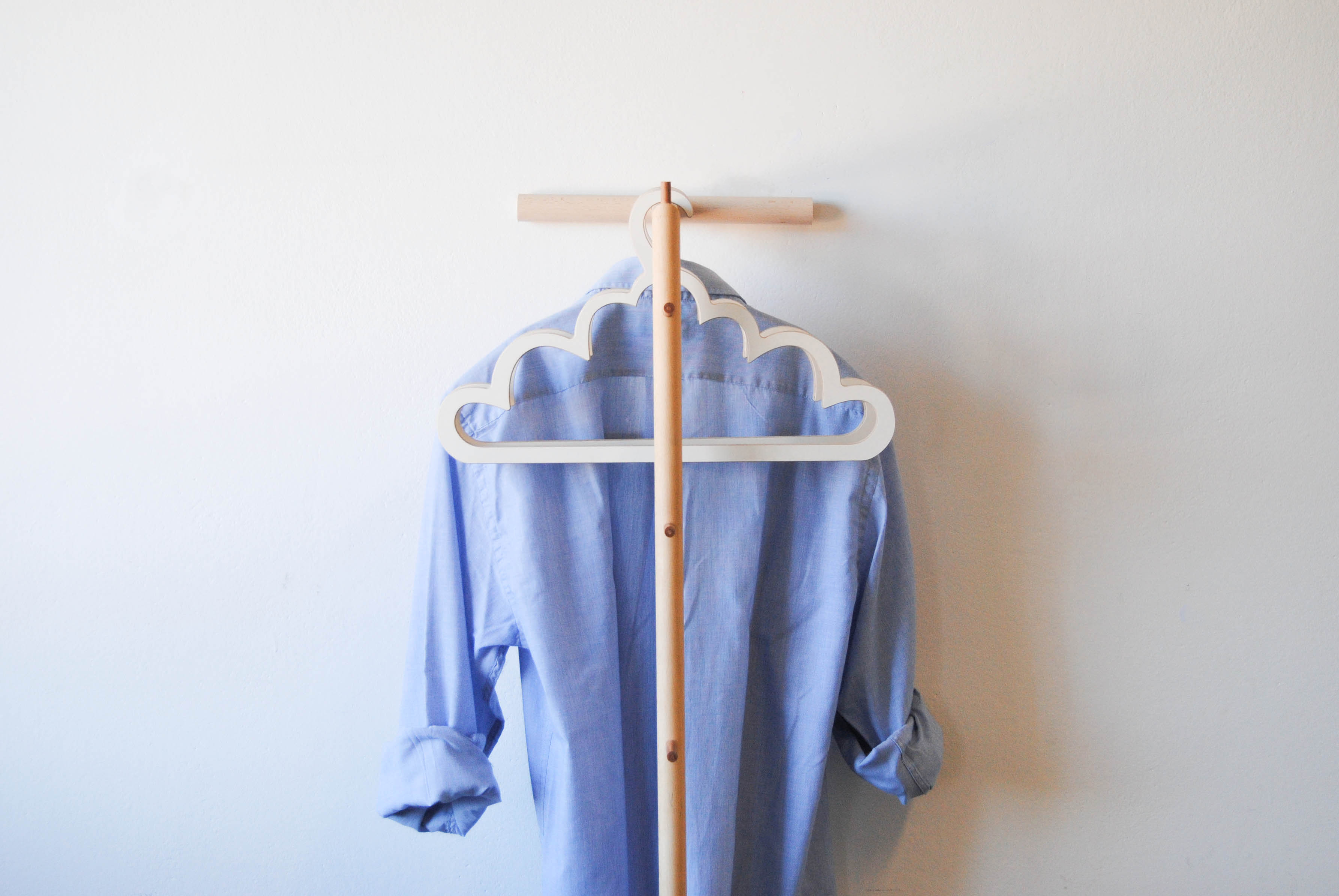 stand james with shirt on the three wooden hangers