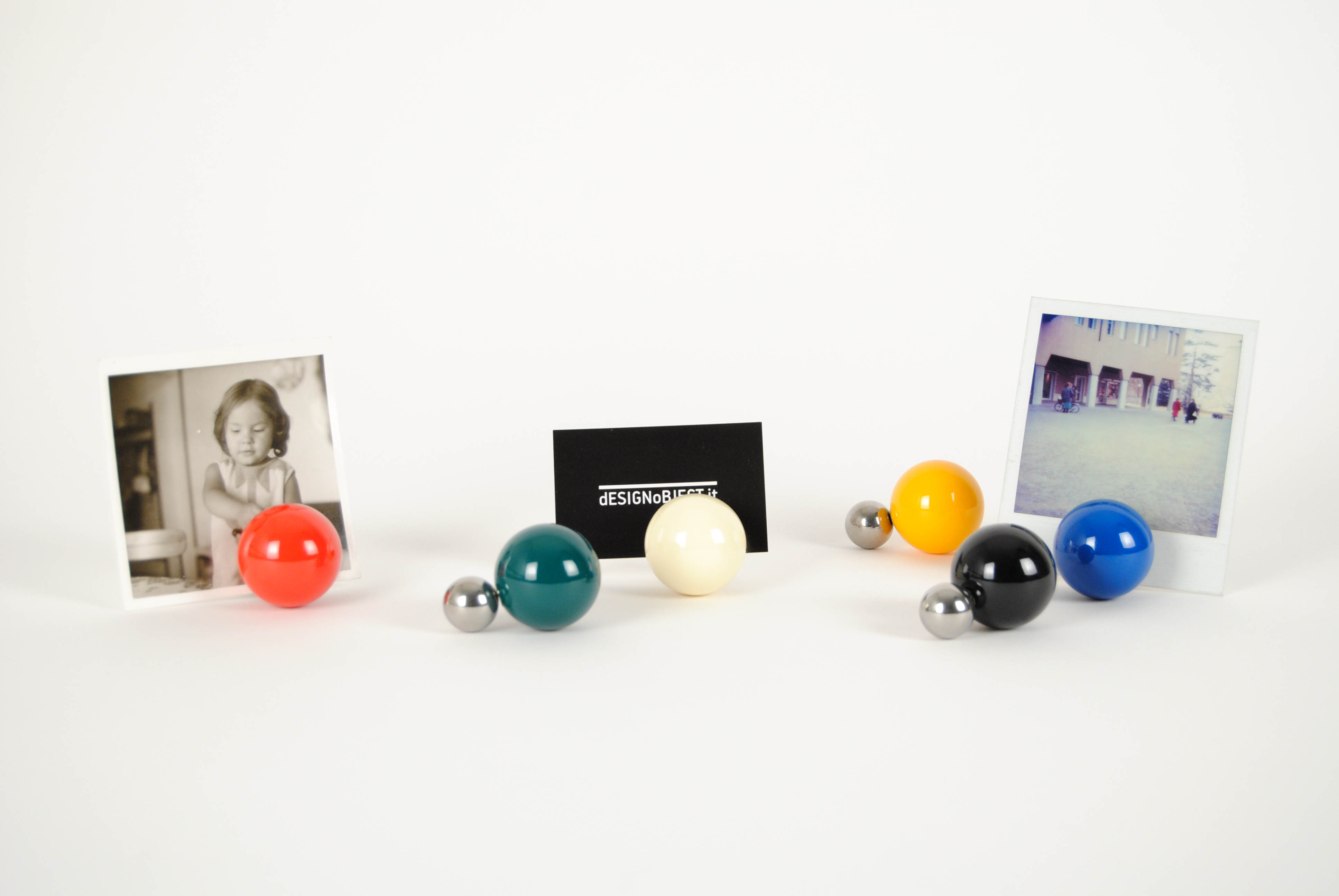 tac photo holders green black blue red white yellow magnetic with the picture inserted between the two balls