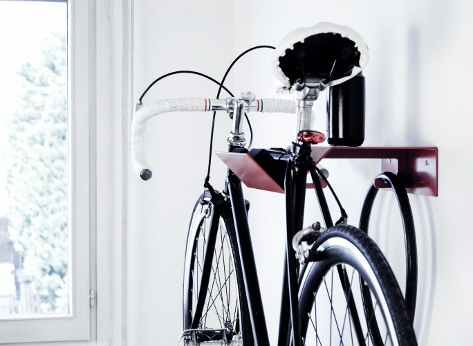 home with the red bike up on the wall