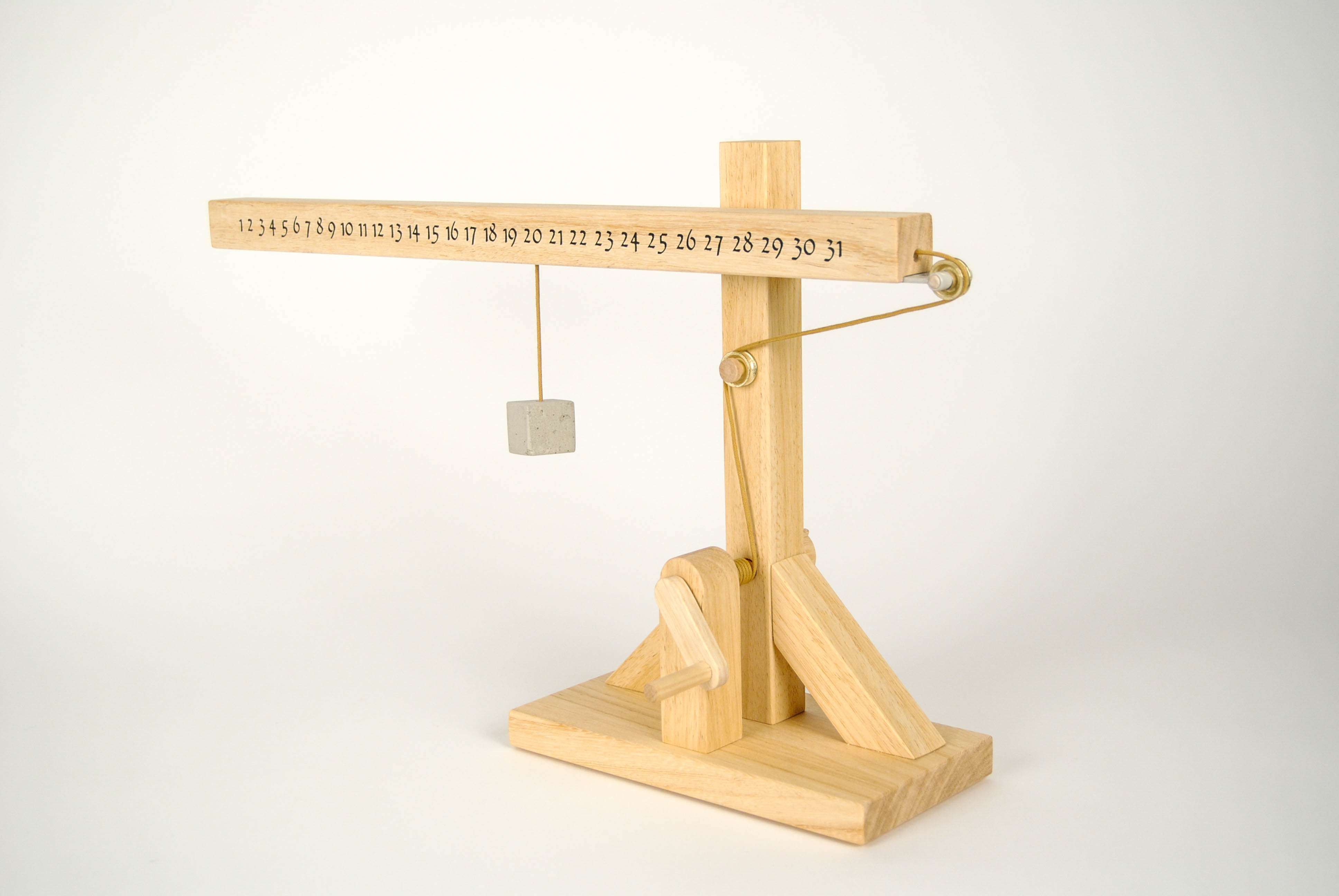leonardo da vinci wooden calendar with printed numbers and rope with stone for sign the date