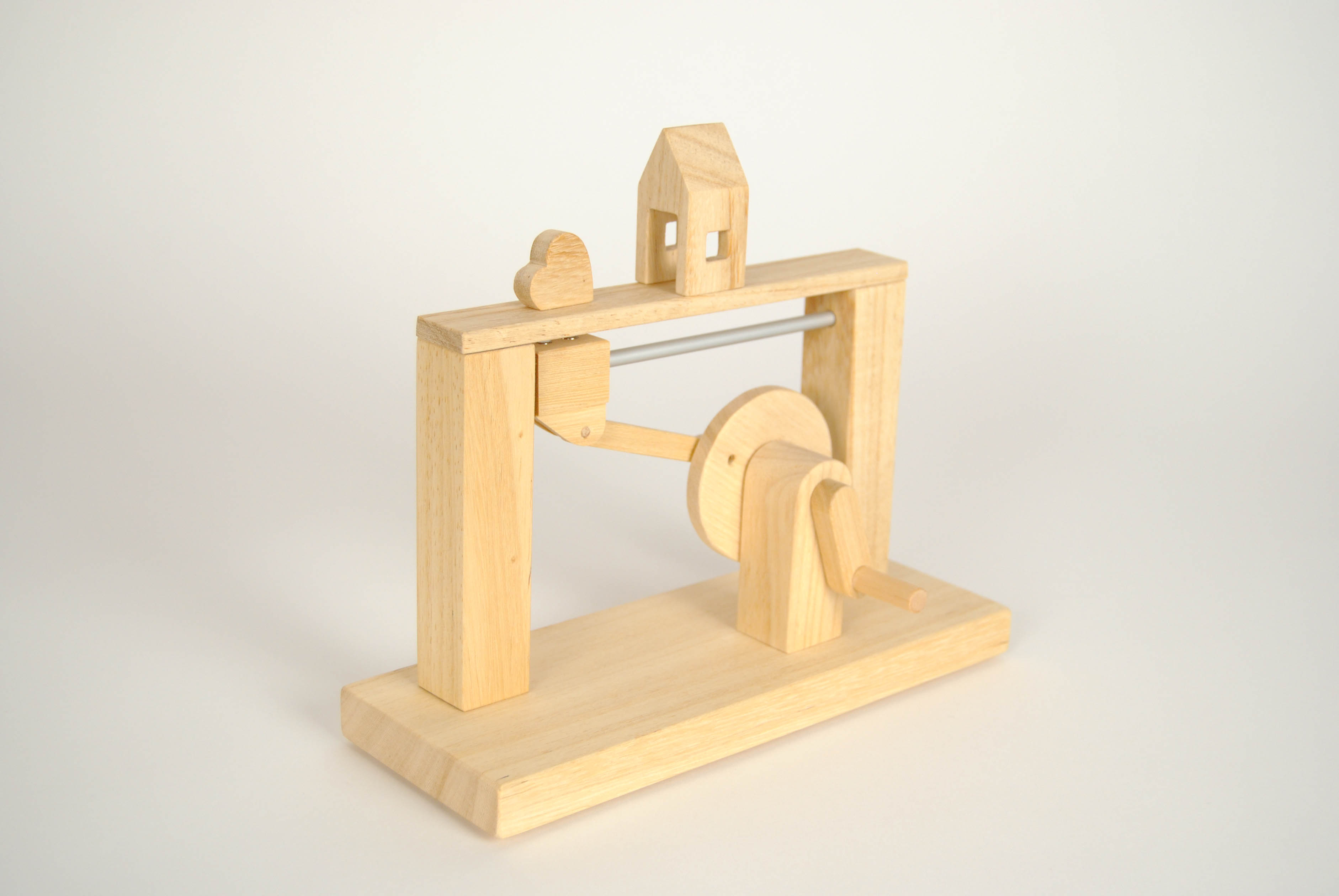 leonardo da vinci magnetic wooden toy with the heart and the house