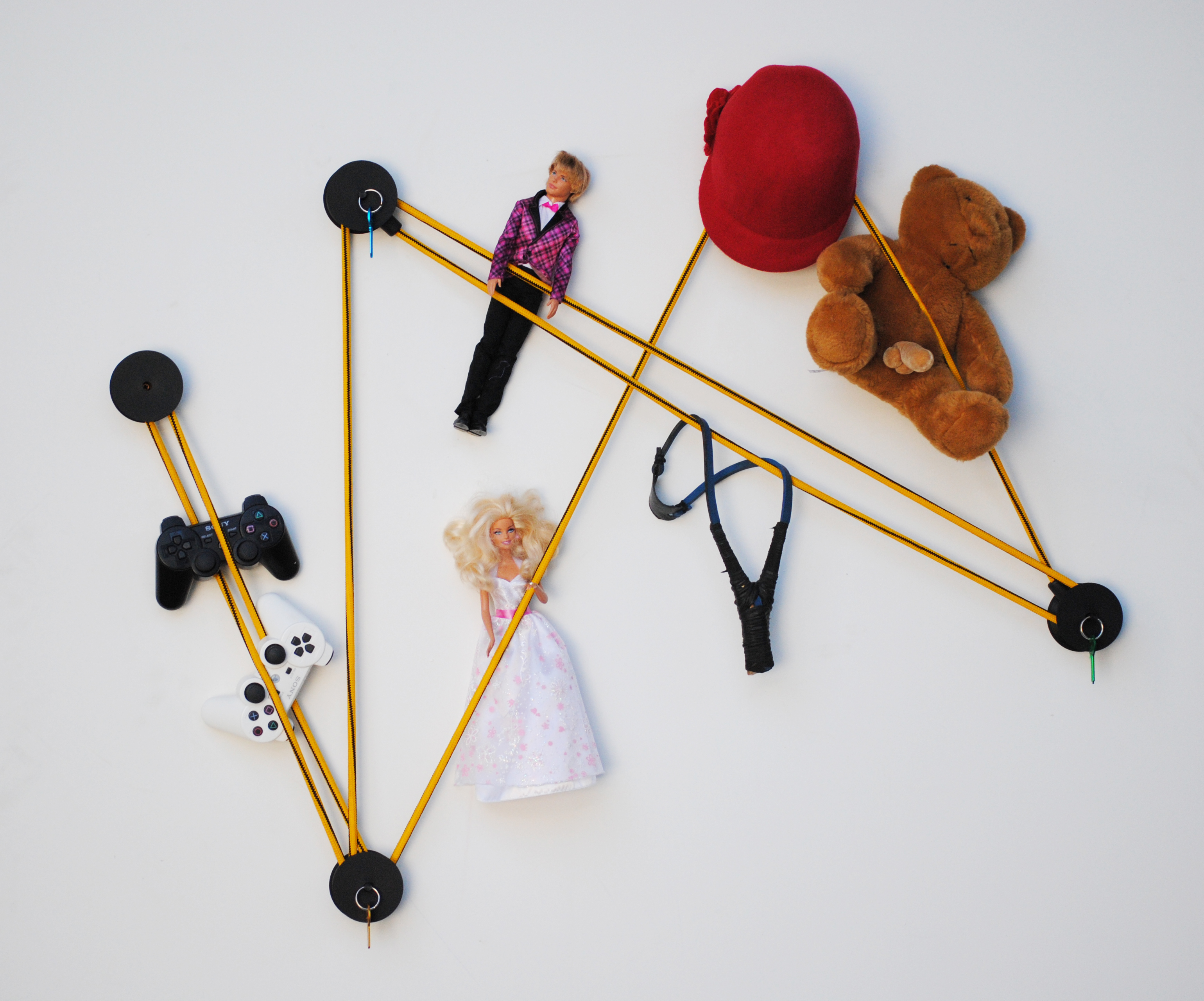 tit black coat hook in pvc and keychain with objects and toys on the elastic rope