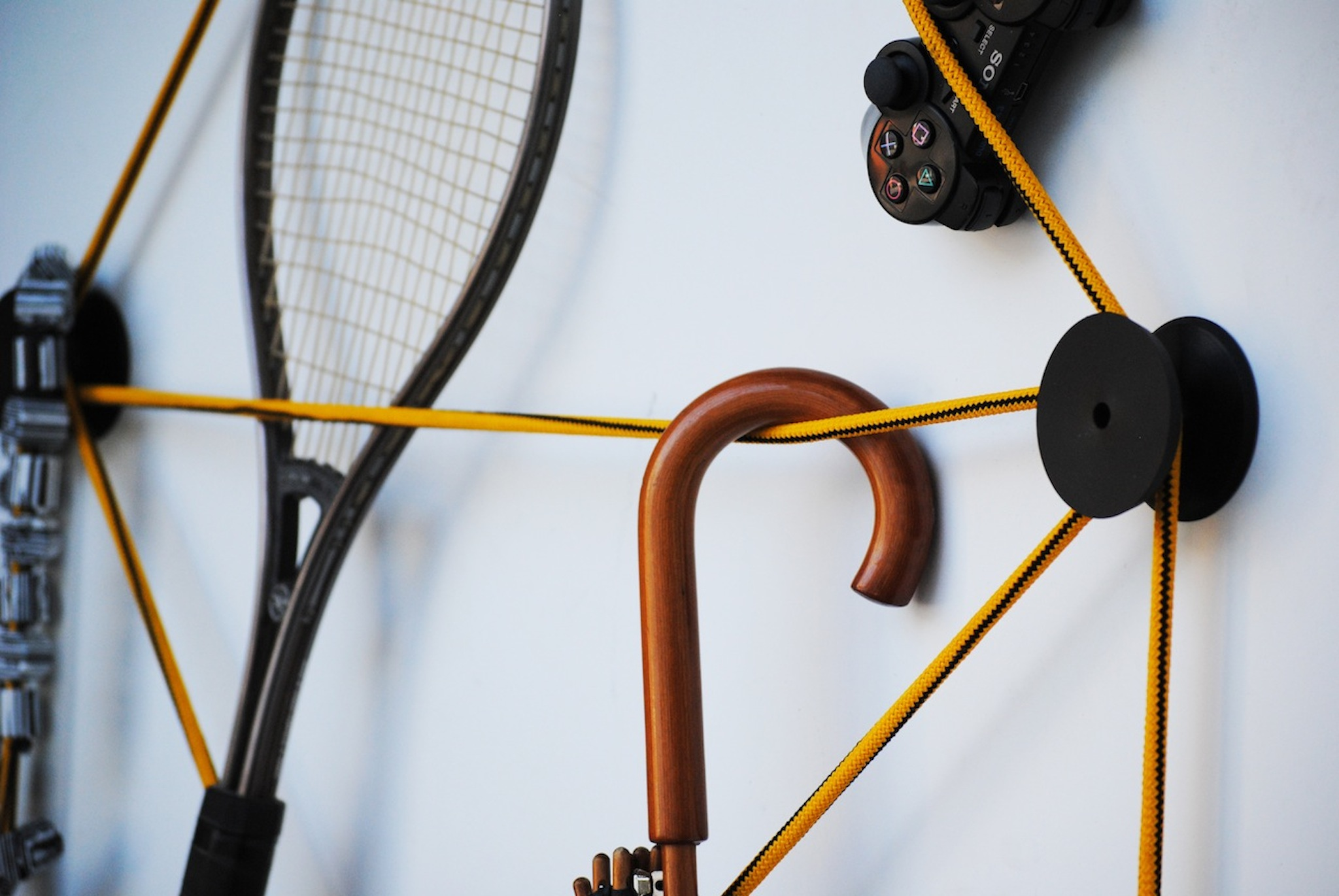tit coat hook with an umbrella non the elastic wire yellow