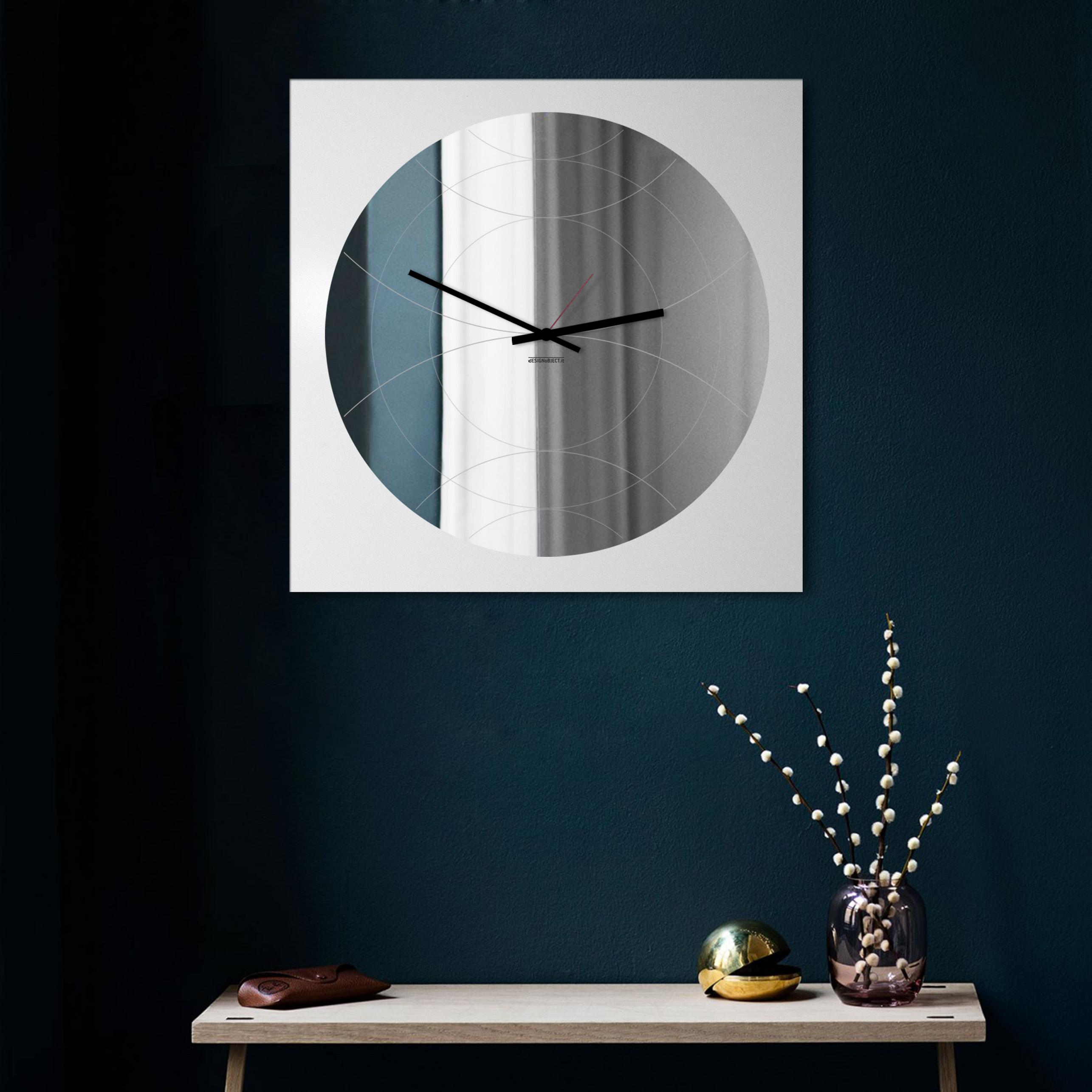 Orologio specchio di design designobject for Specchio da parete componibile